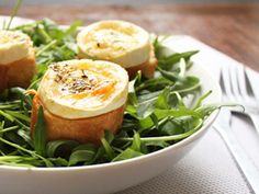 Classic French bistrots warm goat cheese salad recipe. It features rocket salad you can replace by lettuce, French bread stick, goat cheese log and herbs.