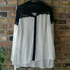 CLEARANCE Beverly Drive Sheer white top With black lace capped shoulder's front and back. Button down, black overlay hides buttons.  High /low hemline. Slits at sides.  Buttons at sleeve ends. Very flowy top. Beverly Drive Tops Button Down Shirts