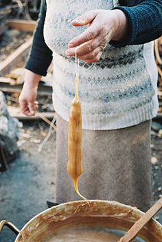 """Soujuk"" which we called Rojik. The tedious process of dipping strings of walnuts into syrupy grape molasses-like mixture and then hanging to dry. Grandma made this for us and it disappeared fast! (See Churchkhela/wiki) Georgian Cuisine, Georgian Food, Armenian Recipes, Russian Recipes, Grape Molasses Recipes, Greek Recipes, Desert Recipes, Cyprus Food, Postres"