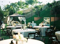 I wonder if the church has tables and chairs that you can borrow for free for your venue.  It would be such a pretty way to do an outside setting