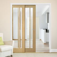 Deanta Twin Telescopic Pocket Norwich American Oak Veneer Doors - Clear Bevelled Safety Glass - Unfinished.    #glassdoors  #telescopicdoors  #glasspocketdoors