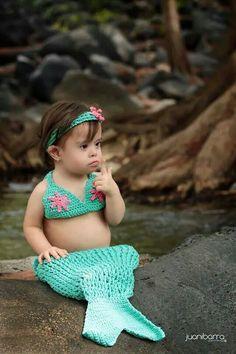 I love her little mermaid bathing suit.