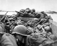 Frightened US infantrymen from the 89th Infantry Division crossed the Rhine river in the landing craft near the town of Saint Goar under heavy enemy fire. Ruhr Pocket.