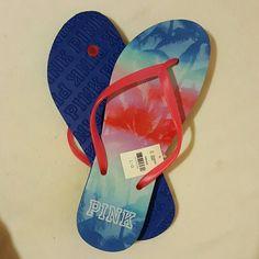 Pink Victoria's Secret flip flops nwt Nwt Victoria's Secret Pink flip flops size large. Red white and blue tropical print. Would consider trade Victoria's Secret Shoes Sandals