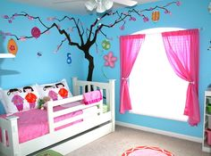 This is how to do blue in a little girl's room. Love the tree in the corner...
