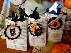 use book pages (from dollar store books vs. vintage) for halloween treat bags with tags.