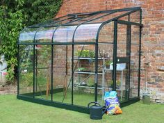 Halls Silverline Lean to Greenhouse in green with Toughened Glazing and curved eaves.Discounted prices and free UK home delivery from Greenhouse Stores. Lean To Greenhouse, Cheap Greenhouse, Greenhouse Effect, Backyard Greenhouse, Greenhouse Growing, Greenhouse Plans, Greenhouse Wedding, Homemade Greenhouse, Underground Greenhouse