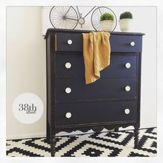 I love the distressed black with white knobs - General Finishes Milk Paint in Lamp Black