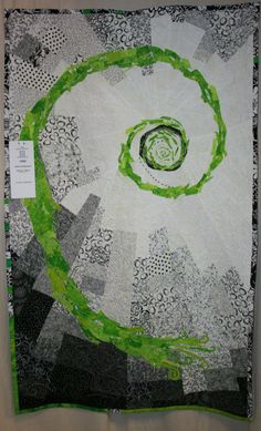https://flic.kr/p/5aqW7p | coils of fibonacci | by Lyn F. Stoodley  few quilts in this show played with black and white, this was one that added a dash of green and lots of beading, as well. still in awe of it.
