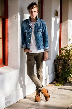 Consider teaming a blue denim jacket with brown chinos for an easy to wear, everyday look. A pair of tan suede boots will bring a strong and masculine feel to any ensemble.  Shop this look for $184:  http://lookastic.com/men/looks/crew-neck-t-shirt-denim-jacket-watch-chinos-boots/6038  — White Crew-neck T-shirt  — Blue Denim Jacket  — Silver Watch  — Brown Chinos  — Tan Suede Boots