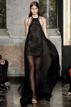 SAINT ALLISON saved this image to their profile. Black sheer halter dress with gold details .
