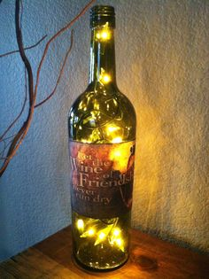 Let the Wine of Friendship never run dry! Wine quote on wine bottle light. from Designs by KKay. Saved to Wine Bottle Lights. Empty Wine Bottles, Lighted Wine Bottles, Bottle Lights, Wine Quotes, White Light, Craft Stores, A Boutique, Scrapbook Paper, Night Light