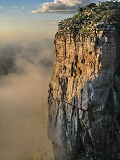 """Tundavala Chasm Situated on the southern plain at a height of 2,225 meters with an impressive decline, this is one of the most spectacular sights of the Mumuilas with natural stone arenas and splendid belvedere from where the village of Bibala (ex. Vila Arriaga) can be seen. Huíla - ANGOLA"""