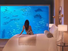 Dubai's Underwater Hotel: Poseidon Suite!  The hotel's Lost Chambers suites provide views from both the bedroom and the bathroom windows into a lagoon filled with 65,000 marine animals. So you can relax on your bed and watch giant manta rays float slowly by.