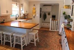 traditional-kitchen-with-penny-tile-herringbone-tile-and-brick-flooring-i_g-ISpdv2ayus94j81000000000-GN16p.jpg 1,024×704 pixels