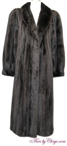 Ranch Mink Coat #RM700; $1975;  Excellent Condition; Size range: 6 - 10. This is a gorgeous genuine natural ranch mink fur coat. It has a Christian Giorgiou label and features a shawl collar, bracelet cuffs and lightly padded shoulders.  The lining is solid black and there is NO MONOGRAM. It closes with hooks and eyes. The mink fur is very silky soft and the pelts are inter-lined. This is a high quality fur coat, and you will feel the thrill of pure luxury when you wear it! Wear your dream fur!