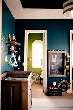 Perfect little boys room!  Use colors differently.  Paint closet this blue color