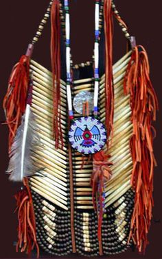 native american breast plate...I feel I could do something decorative with this...