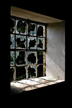 broken windows take frosted contact paper and cut it apart to look like fractured glass.  you can apply it to the inside or outside of the window.