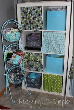 Keeping it Simple: Book Shelf Curtains.  A cute way to hide the mess