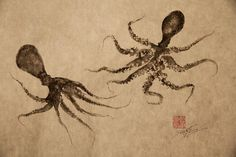 Gyotaku print (Classical Japanese Fish-Rubbing print) of two baby octopi, swimming and frolicking together.