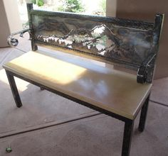 Mountain bench with stone seat. Bench is custom hand-made using steel and featuring torch coloring by carhartcustoms.com