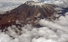 Kilimanjaro wrapped in clouds, Kenya, Africa Mount Kilimanjaro, Kenya Africa, Tanzania, Mists, Places To See, Clouds, Adventure, Mountains, Feb 14