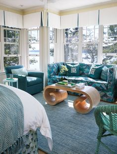 turquoise bedroom sitting area