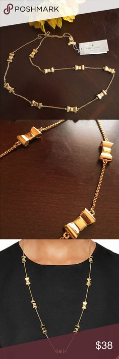 """KATE SPADE GOLD TAKE A BOW SCATTER NECKLACE NWT. Never worn. Kate Spade Take a Bow scatter necklace. 32"""" length. Lobster claw closure, gold plated. Please view photos and ask questions before purchase. Reasonable offers welcome. No trades. Thanks! Kate Spade Jewelry Necklaces"""