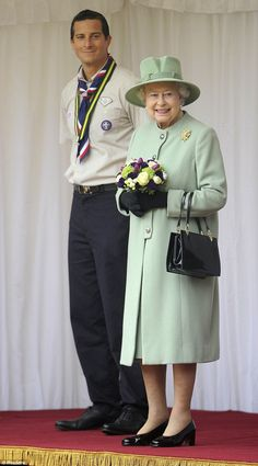 Adventurer Bear Grylls with the Queen during the review of the National Parade of Queen's Scouts at Windsor Castle.