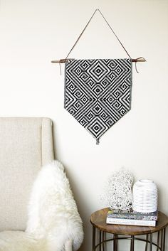 Check out this gorgeous Aztec inspired DIY Wall banner that you can make under 3O mins with a grand total of 4 items! Put this wall hanging on an empty wall or add it to an existing gallery wall to create an eclectic look with frames and other objects. Makes for a great present for a loved one or have a craft party with friends and make it together! ♥