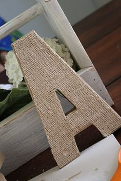 The Virginia House: Letter Making Tutorial. with cardboard letters + burlap. Spell LOVE for bedroom maybe?