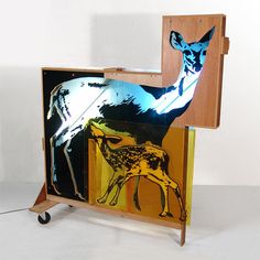 Deer. From the Animals of the Future series. Mixed materials including stencils, plexiglass, found particle board, lights.