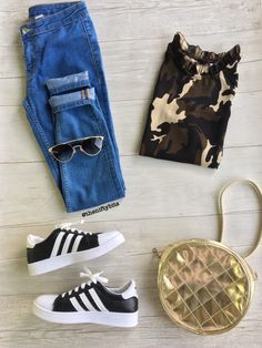Fashion flatlay adidas shoes camouflage tshirt golden sling bag.