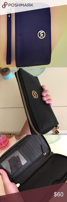 Micheal Kors wristlet/wallet Black, leather wallet/wristlet. In perfect condition. Only been used a handful of times. Strap is detachable. KORS Michael Kors Bags Clutches & Wristlets