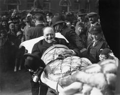 Winston Churchill is carried from a nursing home following being struck by a car in New York City. . He was crossing Fifth Avenue and forgot that cars drove on the opposite side of the road from England, and failed to look to his right. via reddit