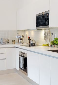 white kitchen, white backsplash- dont know about the steel appliances??? warming to the idea of all white.