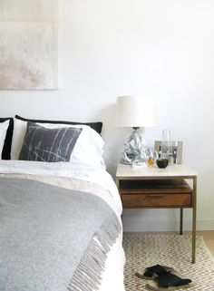 Bed linen and wool throw. An Artistic Couple's Toronto Home | Design*Sponge