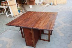 winged-table with cupboards