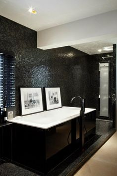 Luxe bathroom, black & white, decorated with photography of John Lennon of Yoko Ono - typical Eric Kuster styling