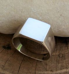 Men signet sterling silver ring. plain design. classic ring for men with a modern finish. clean, simple, light, bright and very impressive men ring. Men usually wear it on their pinky finger but it is beautiful on any other finger. Perfect as a gift for your man. 12 mm plate