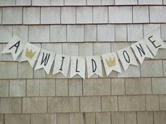 This listing is for a A WILD ONE banner on navy blue flags. Banner details: -burlap pennants each measure 4.5 inches wide by 6.5 inches long.
