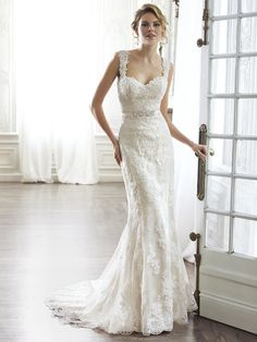 Maggie Sottero - PIA, The pinnacle of romance is found in this streamlined sheath. Rendered in lace  and completed with a dramatic V-back. Beautifully detailed with illusion lace. Finished with sweetheart neckline and delicate cap sleeves. Finished with covered button over zipper and inner elastic closure.