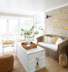 Tour a cottage in Muskoka inspired by the Caribbean, with a soothing white and wood palette and beach decor throughout.