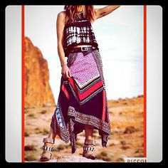 """Free People Bedouin Traveler Skirt * Sold OutHP Flowing charmeuse mixed-print boho handkerchief maxi skirt has sold out in retail, but you can get it here in great condition!   Slip on banded elastic waist fits up to a medium no problem, rayon shell and cotton lining.  Wear with a crop top and lace up sandals and to complete the look throw on a moto style leather jacket and take this baby cross country to your favorite festival! Longest point 30"""". Free People Skirts"""