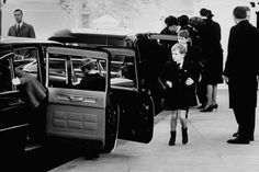 11/24/63: Kennedy children enter limousines to follow the procession as JFK's casket is carried on a military caisson to the Capitol to lie in state in the Rotunda.