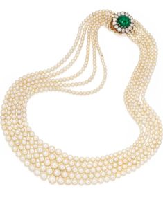 NATURAL PEARL, EMERALD AND DIAMOND NECKLACE  Estimate: 250,000 - 350,000 USD   The five-stranded necklace composed of 551 pearls graduating in size from approximately 7.7 to 2.9 mm, completed by a clasp centered by a cabochon emerald measuring approximately 12.8 by 11.7 mm, framed within old mine-cut diamonds weighing approximately 3.00 carats, length approximately 16¾ inches.
