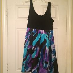 Black and multicolored dress Fabulous dress for any occasion. Black top with multicolored bottom. Zips in the back. Only worn once. Jessica Howard Dresses