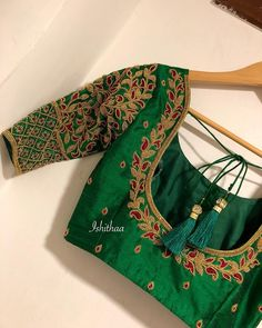 This blouse from Ishithaa design house which stole many of our hearts ! Beautiful bottle green color designer blouse with floret lata design hand embroidery zardosi work. Again for another gorgeous bride ! Ping on 9884179863 to book an appointment. Pattu Saree Blouse Designs, Simple Blouse Designs, Stylish Blouse Design, Fancy Blouse Designs, Bridal Blouse Designs, Blouse Neck Designs, Latest Saree Blouse Designs, Zardosi Work Blouse, Hand Work Blouse Design