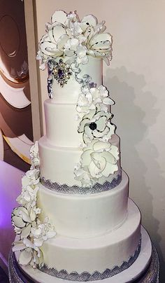 Beautiful wedding cakes with metallic silver and sugar flowers